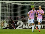 Evian's French forward Kevin Berigaud celebrates with a teammate after scoring a goal during a French L1 football match between Evian and Bordeaux on September 28, 2013