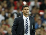 Welsh manager Gary Speed watches his team play against England in their 2012 Group G Euro Qualifier football match at Wembley stadium in London, on September 6, 2011