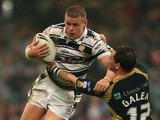Lee Radford of Hull FC is hauled down by Ben Galea of Hull KR during the engage Super League 'Millennium Magic' match between Hull FC and Hull KR at the Millennium Stadium on May 4, 2008