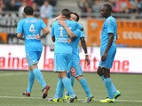 Marseille's French midfielder Mathieu Valbuena celebrates after scoring a goal with his teammate Marseille's French forward Dimitri Payet during the L1 football match between Lorient and Marseille on September 28, 2013