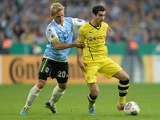 1860 Munich's Stefan Wannenwetsch and Dortmund's Henrikh Mkhitaryan battle for the ball during their German Cup match on September 24, 2013