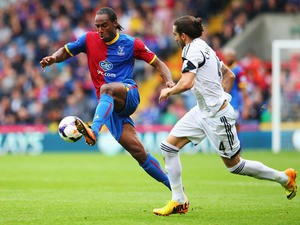 Cameron Jerome of Crystal Palace holds off Chico Flores of Swansea City during the Barclays Premier League match between Crystal Palace and Swansea City at Selhurst Park on September 22, 2013
