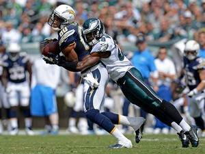 Earl Wolff #28 of the Philadelphia Eagles tackles Wide receiver Malcom Floyd #80 of the San Diego Chargers in the first quarter at Lincoln Financial Field on September 15, 2013