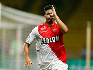 Monaco's Emmanuel Riviere celebrates after scoring the opening goal against Bastia during their Ligue 1 match on September 25, 2013