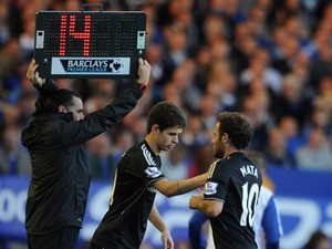 Juan Mata of Chelsea is replaced by Oscar during the Barclays Premier League match between Everton and Chelsea at Goodison Park on September 14, 2013
