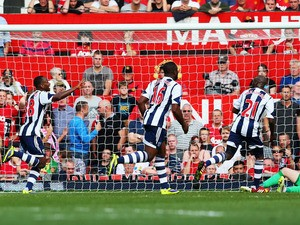 Saido Berahino of West Bromwich Albion celebrates with team mates after scoring during the Barclays Premier League match between Manchester United and West Bromwich Albion at Old Trafford on September 28, 2013