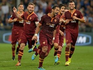 Roma's Mehdi Amine Benatia celebrates with teammates after scoring the opening goal against Sampdoria during their Serie A match on September 25, 2013