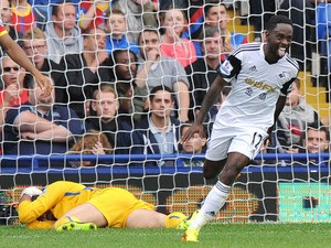 Swansea City's English midfielder Nathan Dyer scores during the English Premier League football match between Crystal Palace and Swansea City at Selhurst Park in south London on September 22, 2013