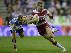 Wigan's Sam Tomkins gets past Leed's Rob Burrow during their Super League qualifying semi-final match on September 27, 2013
