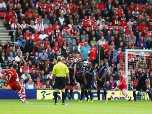 Rickie Lambert of Southampton scores from a free-kick during the Barclays Premier League match between Southampton and Crystal Palace at St Mary's Stadium on September 28, 2013