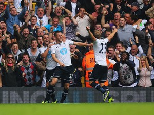 Gylfi Sigurdsson of Tottenham Hotspur (22) celebrates in front of fans with Roberto Soldado (L) and Christian Eriksen (R) during the Barclays Premier League match between Tottenham Hotspur and Chelsea at White Hart Lane on September 28, 2013