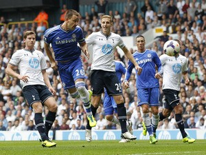 Chelsea's English defender John Terry heads the ball to score a goal during the English Premier League football match between Tottenham Hotspur and Chelsea at White Hart Lane in London on September 28, 2013