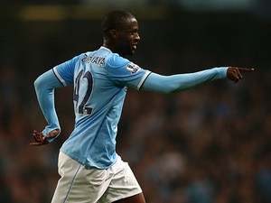 Man City's Yaya Toure scores his team's third goal against Wigan during their League Cup match on September 24, 2013