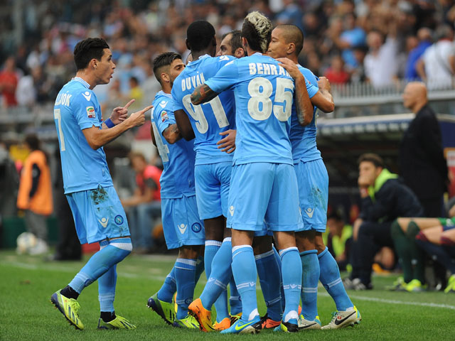 Goran Pandev of Napoli celebrates with his team-mates after scoring the opening goal during the Serie A match between Genoa CFC and SSC Napoli at Stadio Luigi Ferraris on September 28, 2013