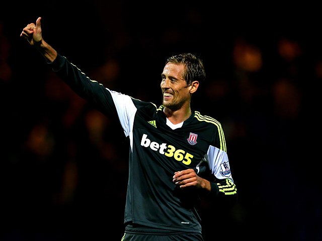 Stoke's Peter Crouch celebrates after scoring his team's second goal against Tranmere during their League Cup match on September 25, 2013