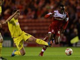 Middlesbrough's Albert Adomah and Huddersfield's Anthony Gerrard battle for the ball during their Championship match on October 1, 2013