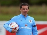 England coach Gary Neville watches a training session on August 11, 2013