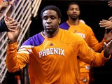 Phoenix Suns' Ike Diogu runs out to the court before the game against Portland Trail Blazers on October 12, 2012