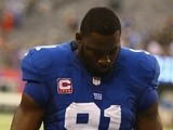 Giants defensive captain Justin Tuck leaves the field after defeat to the Philadelphia Eagles on October 6, 2013