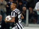 Arturo Vidal of Juventus celebrates after scoring his team's first goal from a penalty to equalise during the UEFA Champions League Group B match between Juventus and Galatasaray AS at Juventus Arena on October 2, 2013