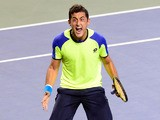 Nicolas Almagro of Spain reacts after his victory against Kei Nishikori of Japan during their quarter-final match of the Japan Open tennis tournament in Tokyo on October 4, 2013