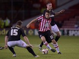 Jose Baxter of Sheffield Utd gets between Mike Jones and Dannie Bulman of Crawley Town during the Sky Bet League One match between Sheffield United and Crawley Town at Bramall Lane on October 04, 2013