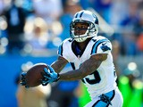 Ted Ginn Jr. #19 of the Carolina Panthers makes a fingertip catch for a touchdown against the New York Giants during play at Bank of America Stadium on September 22, 2013