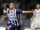 Toulouse forward Wissam Ben Yedder celebrates after scoring a goal against Nice on October O5, 2013