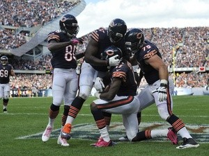 Alshon Jeffery of the Chicago Bears is congratulated after catching a touchdown against the New Orleans Saints on October 6, 2013