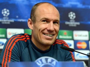 Bayern Munich's Dutch midfielder Arjen Robben addresses a press conference at The City of Manchester stadium in Manchester, northwest England, on October 1, 2013