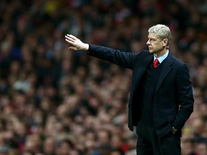 Arsenal manager Arsene Wenger on the touchline during his team's Champions League group match against Napoli on October 1, 2013