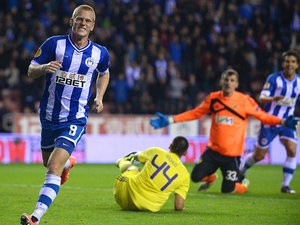 Wigan's Ben Watson celebrates after scoring his team's second goal against Maribor during their Europa League group match on October 3, 2013