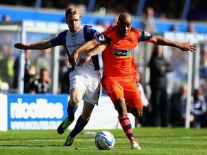 Birmingham's Chris Burke battles for possession with Bolton's Alex Baptiste on October 5, 2013