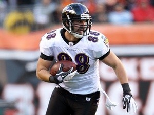 Ravens TE Dennis Pitta runs with the ball against Cincinnati on January 1, 2012