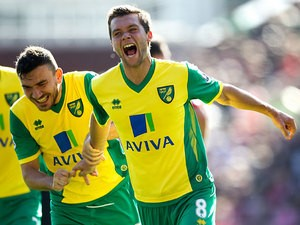 Norwich's Jonny Howson celebrates after scoring the opening goal against Stoke during their Premier League match on September 29, 2013