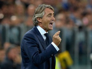 Galatasaray coach AS Roberto Mancini reacts during UEFA Champions League Group B match between Juventus and Galatasaray AS at Juventus Arena on October 2, 2013