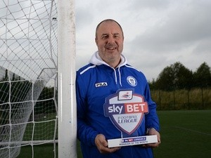 UNDER EMBARGO UNTIL 6AM 4/10/13: Rochdale boss Keith Hill with his September Manager of the Month award on October 3, 2013