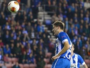 Wigan's Nick Powell heads in the opening goal against Maribor during their Europa League group match on October 3, 2013