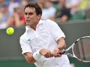 US tennis player Ryan Sweeting in action at Wimbledon on June 27, 2013