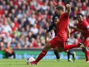 Liverpool captain Steven Gerrard strikes to score a penalty against Crystal Palace during the Barclays Premier League match on October 5, 2013