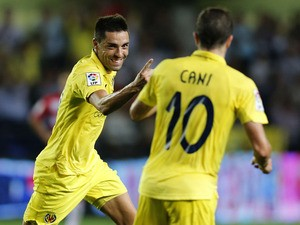 Villarreal's midfielder Bruno Soriano celebrates his goal with Villarreal's midfielder Cani during the Spanish league football match Villarreal CF vs Granada FC at El Madrigal stadium in Villareal on October 4, 2013
