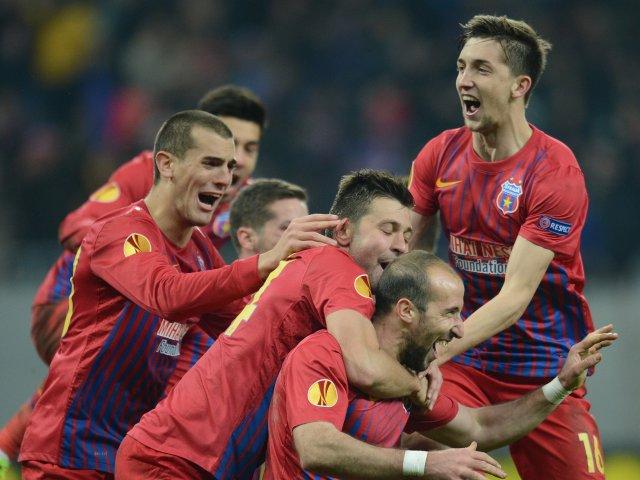 Steaua Bucuresti players celebrate their win over Ajax in February 2013.