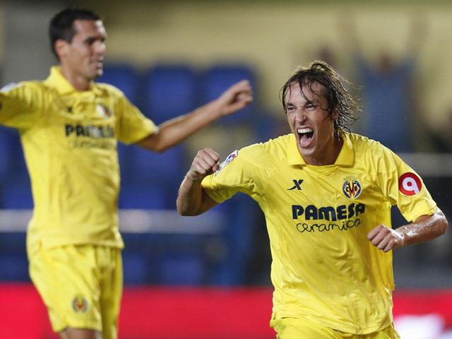 Villarreal's midfielder Tomas Pina celebrates his goal during the Spanish league football match Villarreal CF vs Granada FC at El Madrigal stadium in Villareal on October 4, 2013