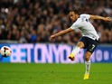 Andros Townsend of England scores their third goal during the FIFA 2014 World Cup Qualifying Group H match between England and Montenegro at Wembley Stadium on October 11, 2013
