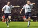 Wayne Rooney and Frank Lampard celebrate the latter's goals during a World Cup qualifier against Poland on October 12, 2005.