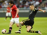 Manchester's striker Angelo Henriquez and AIK's defender Alexander Milosevic vie for the ball during the friendly football match AIK vs Manchester United on August 6, 2013