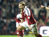 Danish forward Nicklas Bendtner celebrates scoring during the FIFA 2014 World Cup Group B qualifying football match Denmark vs Italy in Copenhagen, Denmark on October 11, 2013