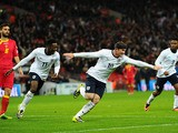 Wayne Rooney of England celebrates scoring the first goal with Danny Welbeck of England during the FIFA 2014 World Cup Qualifying Group H match between England and Mon