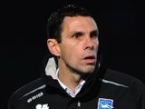 Gus Poyet stands on the touchline during Brighton & Hove Albion vs. Portsmouth in 2011.