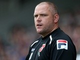 Morecambe manager Jim Bentley looks on during the Sky Bet League Two match against Northampton Town on September 28, 2013